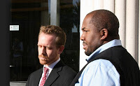 Attorney Lance Rogers, Left and Jovan Jackson